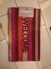 COLOURFUL WELCOME MAT