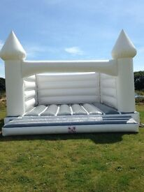 White Wedding Adult Bouncy Castle for Hire. Have absolutely beautiful photos!