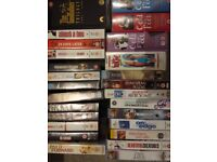 100 assorted VHS videos, DVD's, plus tv/video player ALL FREE!