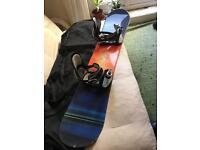 Snowboard with bindings and bag