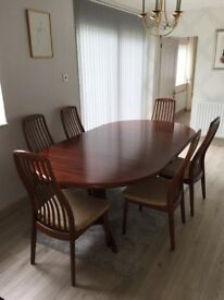 Large, size adjustable dark Danish rosewood dining table with matching six chairs and cover