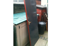 Exterior wooden door (probably fire door)