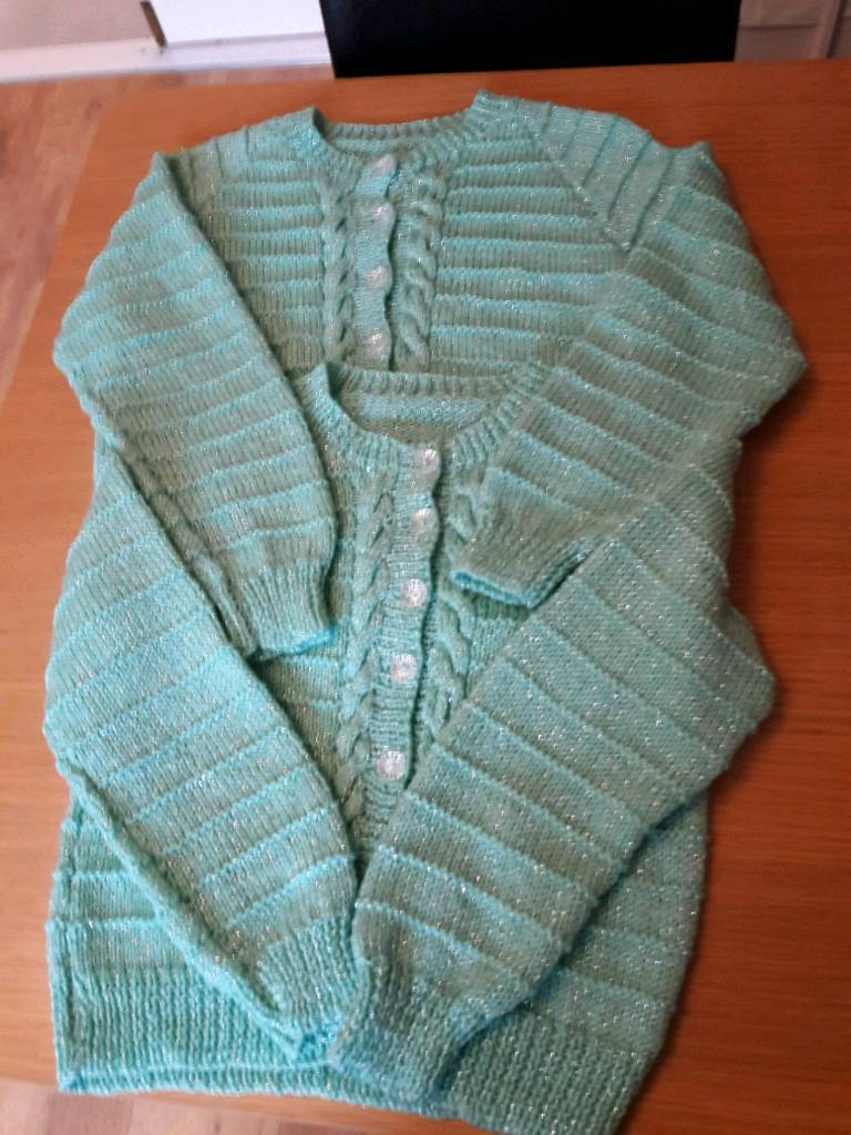 Two children's green cardigans