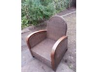 Wicker garden chair with armrests