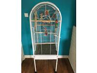 Budgie and cage with extra