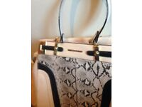 Beige and black snake print bag