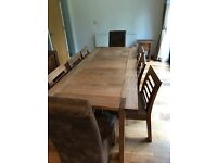 Dining table with 6 matching chairs by furniture makers Willis & Gambier