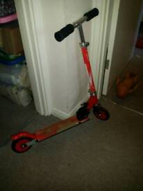 Foldable and height adjustable kids scooter