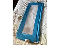 Blue child's bed rail