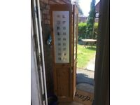 Glazed two panel bi fold door, with bar and fittings, solid pine