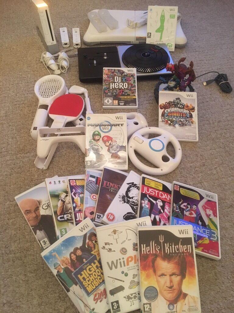 DELUXE BUNDLE - Nintendo Wii Console + Wii Fit Board + Skylanders + Mario Kart + 15 Games + More