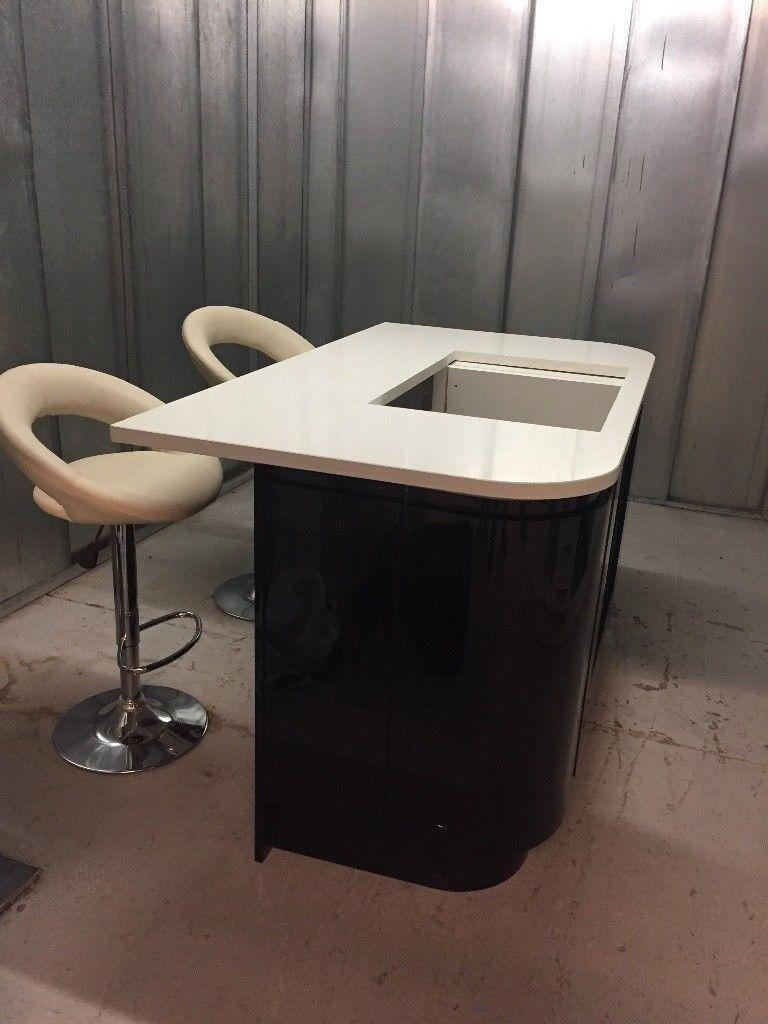 Kitchen island by Corian® with Okite quartz worktop.   in Kensington ...