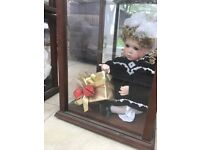 Vintage doll, never been played with, comes with certificate of authenticity, excellent condition.
