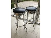 Two Chrome and Black Barstools in good condition