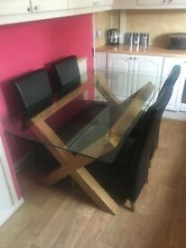 Beautiful glass and wooden dining table with 4 leather n oak chairs.
