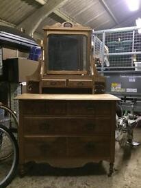 Old chest of drawers with mirror