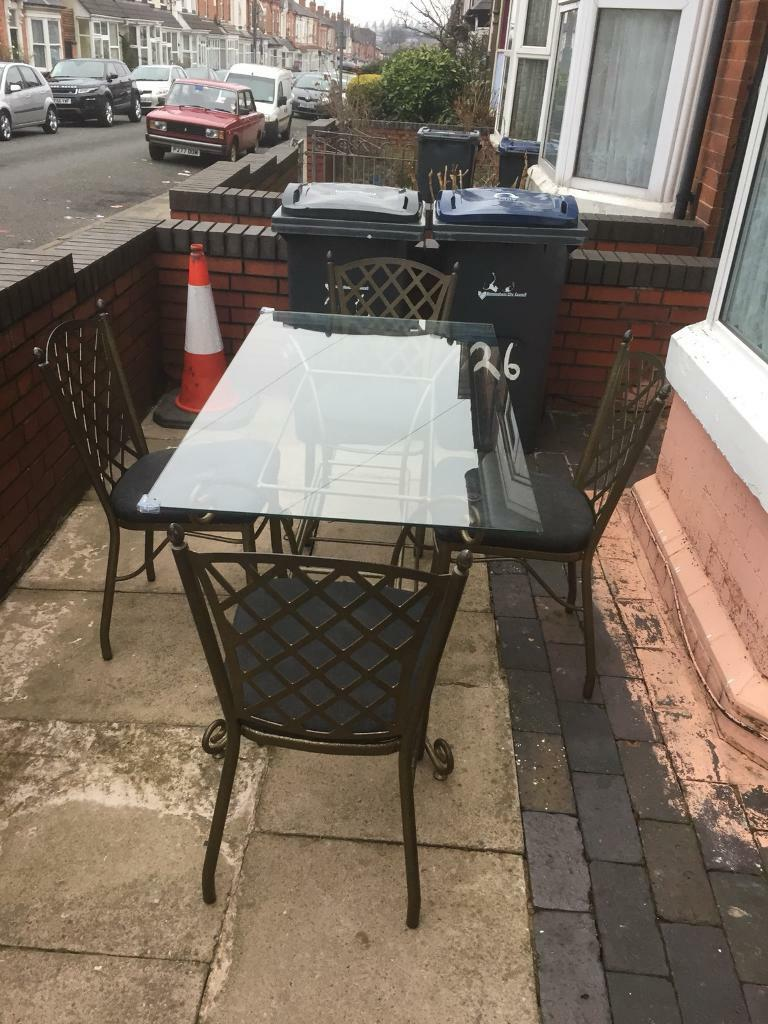 solid glass dining Table with 4 chairs in great condition