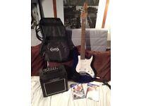 ASHTON Guitar + Amp 'Starter Set-up' Bag + DVD + selection of spare strings.