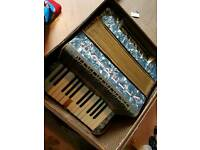 Vintage accordion with case