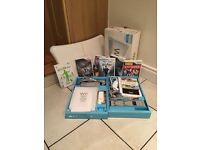 Nintendo Wii plus Wii Fit Board and Games