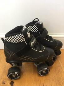 Black and white Anarchy roller skates