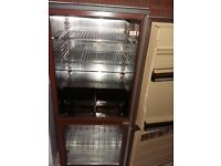Fridge-freezer in good working order ready to colect! Brown colour!