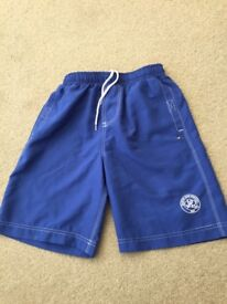 Boy's swim shorts age 13/14 with QPR badge on left side, never worn