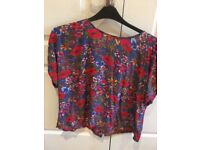 Excellent condition. Multi coloured (red/blues) Marks & Spencer blouse/top. size 18.
