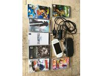 PSP console with power cable, case and 7 games
