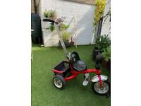 Little black and red tricycle
