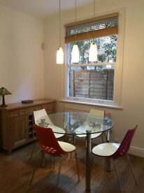 4 Calligaris 'Jam' dining chairs, very good condition, and extending glass glass table seats 4