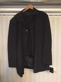 Pinstriped suit new with tags