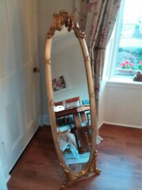 FULL LENGTH MIRROR .Ornate oval solid wood carved in period style.