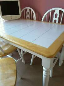 Beautiful contemporary white tiled top kitchen table