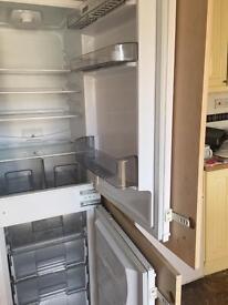 Fridge freezer in wooden cabinet