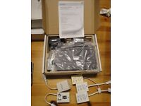 Four boxed D-Link DSL-2640R Broadband Wireless ADSL2+ Routers kits plus five random filters.