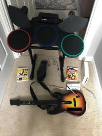 Wii fit board with guitar hero & drum kit