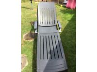 Large garden lounger with cover