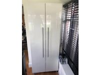 Tall white gloss cupboard with shelves