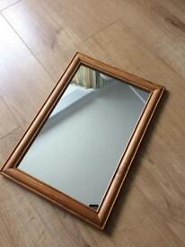 Wall mirror in wooden frame