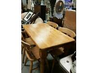Solid heavy pone table and 4 chairs