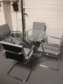 Stunning grey and chrome dining table and chairs. New