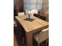 Light Wood effect veneer Dining Table and 6 Leather look PVC Chairs