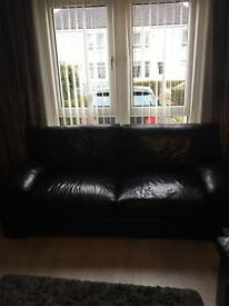 2x black leather sofa from John lewis