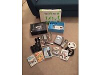 Nintendo Wii bundle inc. Black Console, Wii Fit Plus and We Sing