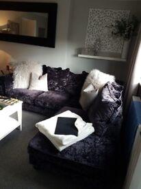 Designer velvet sofa with matching footstool