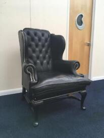 Black soft leather chesterfield wing armchair