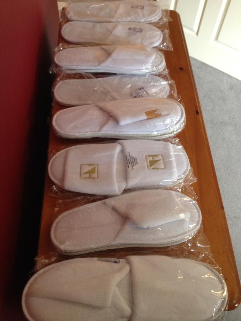 8 new pairs of guest slippers