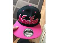 Black and pink New York cap