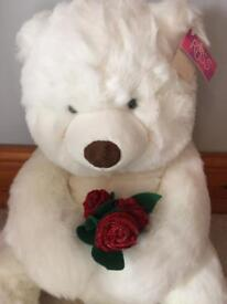 Large white teddy with glitter roses